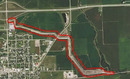 2014 National Agriculture Imagery Program photo showing construction of the Shell Creek levee in Schuyler, Nebraska. The levee is outlined in red.