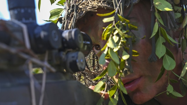 A Marine scout sniper candidate with Scout Sniper Platoon, Weapons Company, 2nd Battalion, 2nd Marine Regiment looks through the scope of his weapon during a stalking exercise in the vicinity of SR-10 aboard Marine Corps Base Camp Lejeune, North Carolina, April 22, 2015. The exercise taught Marines the importance of concealment during movement to a target and while firing from a position at a target. The stalking exercise was one of many conducted by Marines attending the Scout Sniper Basic Preparation Course over the course of two weeks during the month of April.