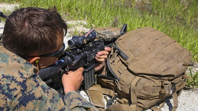 Lance Cpl. Richard Marsh, a scout sniper candidate with Scout Sniper Platoon, Weapons Company, 2nd Battalion, 2nd Marine Regiment fires at a target from an unknown distance during a live-fire exercise at SR-10 aboard Marine Corps Base Camp Lejeune, North Carolina, April 22, 2015. The unknown distance live-fire exercise was the last event during a two week Basic Scout Sniper Course Preparation Course.