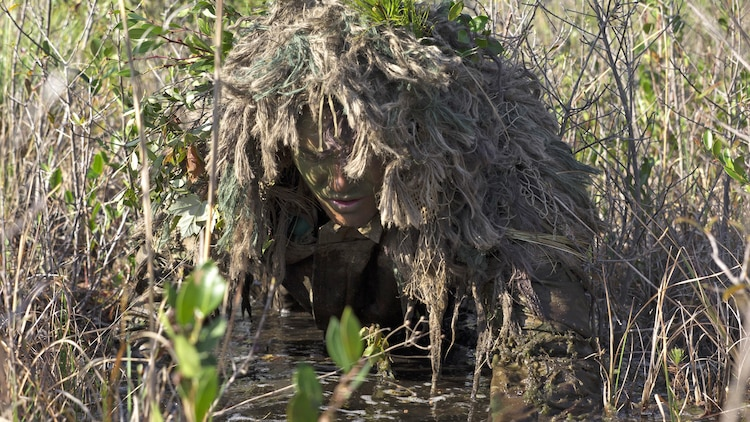 Corporal Barton Harmon, a scout with Scout Sniper Platoon, Weapons Company, 2nd Battalion, 2nd Marine Regiment, crawls through a flooded field to get into a firing position during a stalking exercise in the vicinity of SR-10 aboard Marine Corps Base Camp Lejeune, North Carolina, April 22, 2015. The stalking exercise was one of many conducted by Marines attending the Scout Sniper Basic Preparation Course over the course of two weeks.