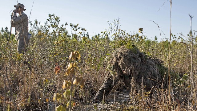 Corporal Barton Harmon, a scout with Scout Sniper Platoon, Weapons Company, 2nd Battalion, 2nd Marine Regiment crawls through a flooded field during a stalking exercise in the vicinity of SR-10 aboard Marine Corps Base Camp Lejeune, North Carolina, April 22, 2015. The stalking exercise was one of many conducted by Marines attending the Scout Sniper Basic Preparation Course over the course of two weeks during the month of April.
