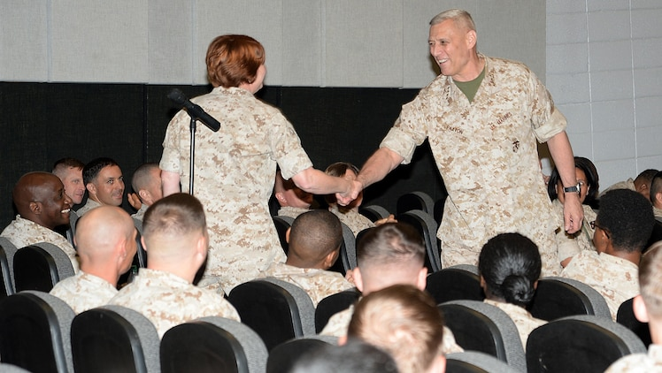Assistant Commandant of the Marine Corps Gen. John M. Paxton Jr. shakes hands with Maj. Billie Rankin, Marine Corps Logistics Command, during a town hall meeting at Marine Corps Logistics Base Albany's Base Theater, May 5. Paxton conducted the meeting to update his Marines here on the state of the Marine Corps.