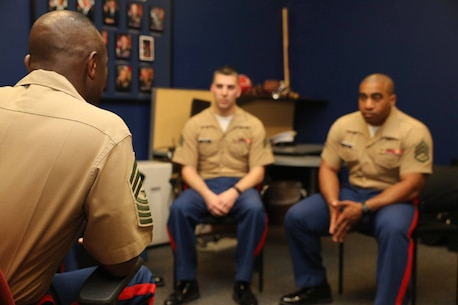 Sergeant Major Samuel Heyward Jr., Sergeant Major Marine Corps Recruiting Command, spoke with Sergeant Richard H. Hayes and Staff Sergeant Christian V. Harris at Recruiting Sub-Station South East Indianapolis during a Recruiting Station Indianapolis visit April 27, 2015. Photo by LCpl Zachery B. Martin