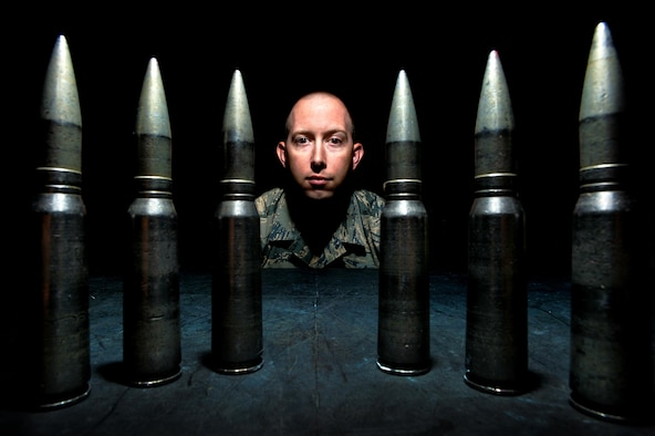 Tech. Sgt. Robert Kurz, the 20th Equipment Maintenance Squadron assistant first sergeant, stands behind training 20mm rounds at Shaw Air Force Base, S.C., April 28, 2015. Kurz realigned the inspection and tracking process for the F-16 Fighting Falcon's Gatling gun system that affected the Air Force's entire F-16 fleet. (U.S. Air Force photo/Senior Airman Jensen Stidham)