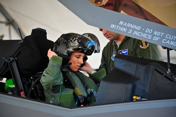 Lt. Col. Christine Mau, 33rd Operations Group deputy commander, puts on her helmet before taking her first flight in the F-35A on Eglin Air Force Base, Florida, May 5, 2015. Mau, who previously flew F-15E Strike Eagles, made history as the first female F-35 pilot in the program. (U.S. Air Force photo/Staff Sgt. Marleah Robertson)