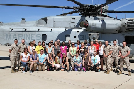 Teachers and influencers with the 2015 Educator's Workshop visited Marine Corps Air Station Miramar to look at Marine aircrafts and speak with those who work on the flight line. The workshop is designed to show educator's the process of turning a young adult into a basically trained United States Marine.