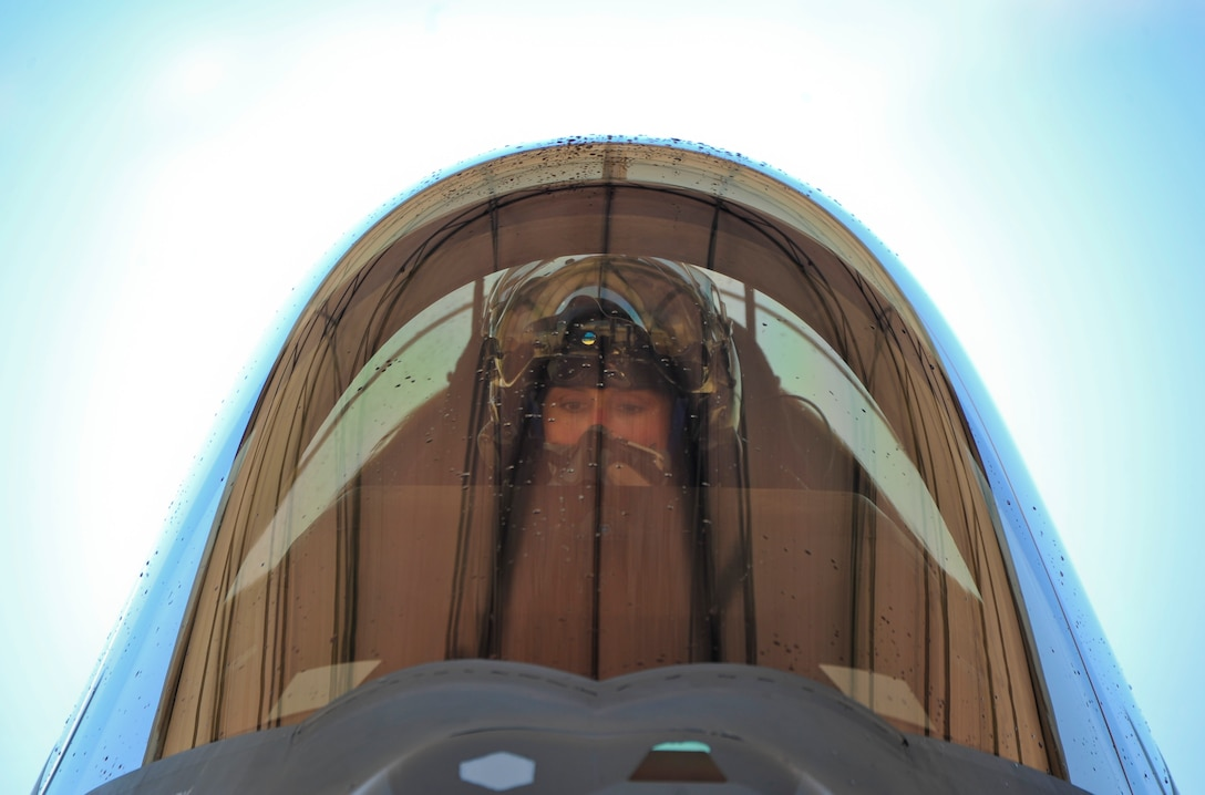 Lt. Col. Christine Mau, 33rd Operations Group deputy commander, prepares to exit her F-35A after completing her first training flight at Eglin Air Force Base, Florida, May 5, 2015. Mau, who previously flew F-15E Strike Eagles, made history as the first female F-35 pilot in the program. (U.S. Air Force photo/Staff Sgt. Marleah Robertson)