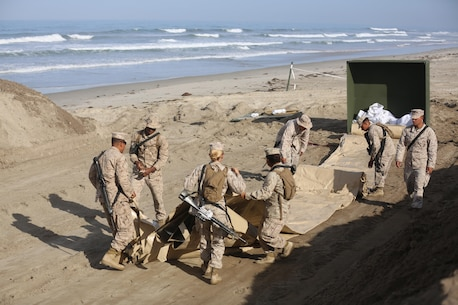 U.S. Marines with Bulk Fuel Company, 7th Engineer Support Battalion, 1st Marine Logistics Group,  roll out a berm liner on Camp Pendleton Calif., May 1, 2015. The berm liner is used as part of the Beach Unloading System used to house fuel which is pumped from a ship off shore. (U.S. Marine Corps Photo by Cpl. Rodion Zabolotniy, Combat Camera/Released)