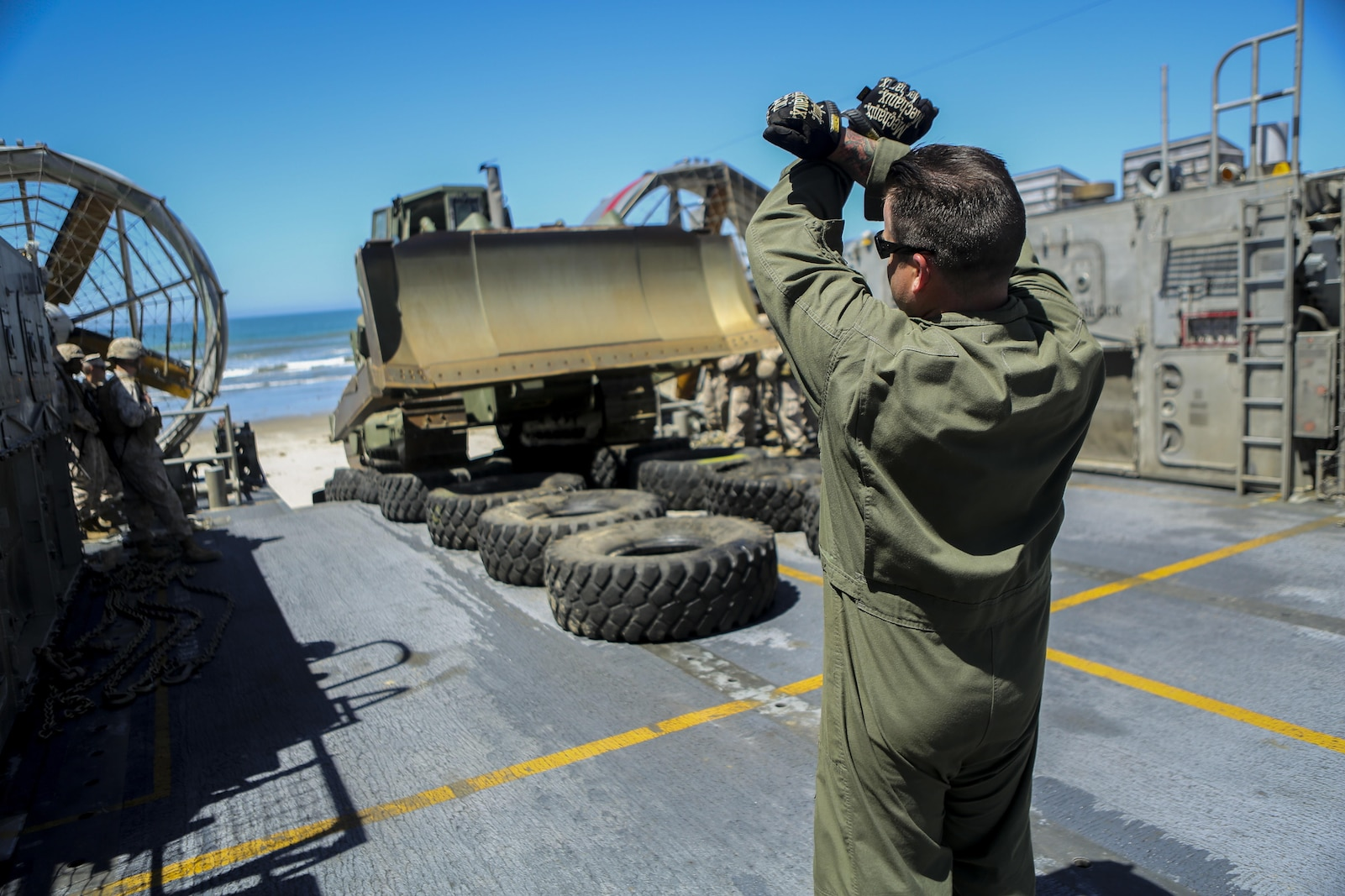 A U.S. Sailor with Assault Craft Unit 5 loads a U.S. Marine Humvee onto a Landing Craft Air Cushioned (LCAC) as part of an exercise along side Bulk Fuel Company, 7th Engineer Support Battalion aboard Camp Pendleton, Calif., April 27, 2015. This exercise reinforces the Marine Corps' role as an amphibious force in readiness by maintaining capabilities through realistic training. (U.S. Marine Corps photo by Lance Cpl. Lauren Falk/Released)