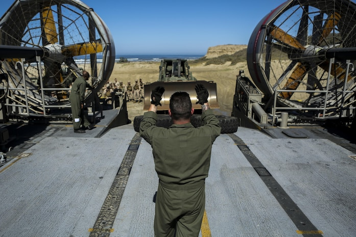 A U.S. Sailor with Assault Craft Unit 5 loads a U.S. Marine Humvee onto a Landing Craft Air Cushioned (LCAC) as part of an exercise along side Bulk Fuel Company, 7th Engineer Support Battalion aboard Camp Pendleton, Calif., April 27, 2015. This exercise reinforces the Marine Corps role as an amphibious force in readiness by maintaining capabilities through realistic training. (U.S. Marine Corps photo by Lance Cpl. Lauren Falk/Released)