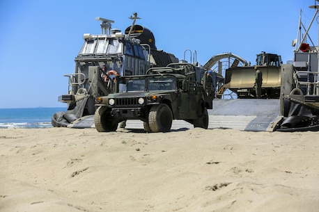 U.S. Navy Landing Craft Air Cushioned (LCAC) vehicle from Assault Craft Unit 5 unloads a U.S. Marine Humvee on Red Beach as part of an exercise along side Bulk Fuel Company, 7th Engineer Support Battalion aboard Camp Pendleton, Calif., April 27, 2015. This exercise reinforces the Marine Corps' role as an amphibious force in readiness by maintaining capabilities through realistic training. (U.S. Marine Corps photo by Lance Cpl. Lauren Falk/Released)