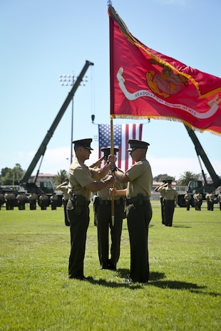 U.S. Marine Corps Col. Eric B. Kraft, off going commanding officer, Headquarters Regiment, 1st Marine Logistics Group, 1 Marine Expeditionary Force, passes the colors to on coming commanding officer Col. Phillip N. Frietze during the Change of Command Ceremony for Headquarters Regiment aboard Camp Pendleton Calif., May 1, 2015. The Change of Command Ceremony for Headquarters Regiment showcased the passing of command from Col. Eric B. Kraft to Col. Phillip N. Frietze. (U.S. Marine Corps photo by Lance Cpl. Lauren Falk/Released)