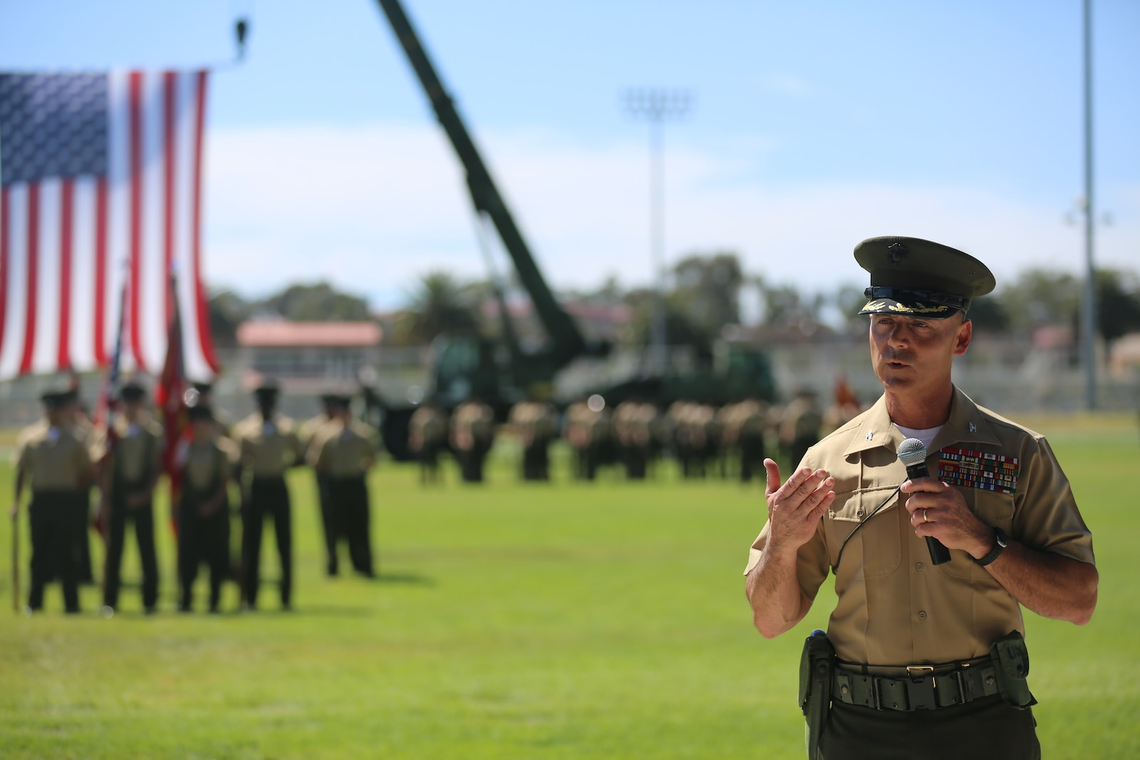 U.S. Marine Corps Col. Phillip N. Frietze, on coming commanding officer, Headquarters Regiment, 1st Marine Logistics Group, 1 Marine Expeditionary Force, addresses a crowd during the Change of Command Ceremony for Headquarters Regiment aboard Camp Pendleton Calif., May 1, 2015. The Change of Command Ceremony for Headquarters Regiment showcased the passing of command from Col. Eric B. Kraft to Col. Phillip N. Frietze. (U.S. Marine Corps Photo by Cpl. Rodion Zabolotniy, combat camera/ released)