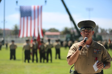 U.S. Marine Corps Col. Eric B. Kraft, off going commanding officer, Headquarters Regiment, 1st Marine Logistics Group, 1 Marine Expeditionary Force, addresses a crowd during the Change of Command Ceremony for Headquarters Regiment aboard Camp Pendleton Calif., May 1, 2015. The Change of Command Ceremony for Headquarters Regiment showcased the passing of command from Col. Eric B. Kraft to Col. Phillip N. Frietze. (U.S. Marine Corps Photo by Cpl. Rodion Zabolotniy, combat camera/ released)