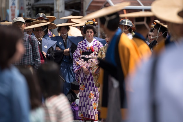 Cpl. Alissa P. Schuning, the social media noncommissioned officer with the Public Affairs Office aboard Marine Corps Air Station Iwakuni, Japan, walks in the Daimyo Procession during the 38th Annual Kintai-kyo Bridge Festival, in Iwakuni City, April 29, 2015. The procession is an annual parade that reenacts the return of a daimyo, one of the most powerful feudal rulers who is subordinate only to the shogun and his entourage from the capital of Japan.