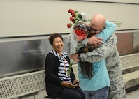 After months of separation, Tech. Sgt. Donald Martinez Jr., 31st Tests and Evaluation Squadron, reunites with his wife Araceli at the Commissary where she works as a bagger May 5. (U.S. Air Force photo by Rebecca Amber)