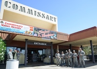 Airmen from the 31st Test and Evaluation Squadron wait outside the Commissary each with a single red rose for Araceli Martinez, whose husband surprised her after a six-month deployment. (U.S. Air Force photo by Rebecca Amber)