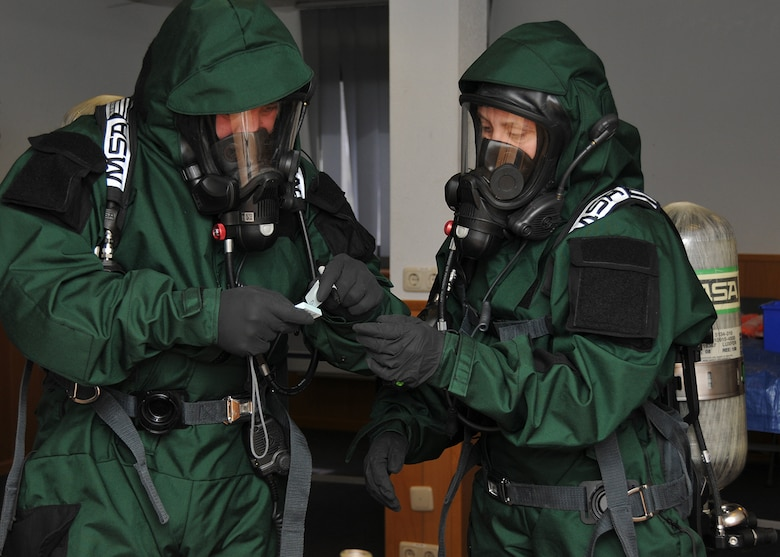 150506-Z-FV422-056 Technical Sgt. Nicole Locke, 104th Emergency Management Flight, Barnes Air National Guard Base, Westfield, Mass., and active-duty Master Sgt. Tony Malbrough, sample an unknown substance for testing during an exercise May 6, 2015, Spangdahlem Air Base, Germany. Locke is training on Active CBRNE (Chemical Biological Radiological Nuclear and High- Yield Explosives) Response with the active-duty members to enhance their Hazmat Technician Certification. . This is a required training that needs to be done by the guard and the active duty. Doing the training together allows them to increase their knowledge by sharing their experiences and use different types of equipment. (U.S. Air National Guard photo by 2nd Lt. Bonnie Harper/Released)