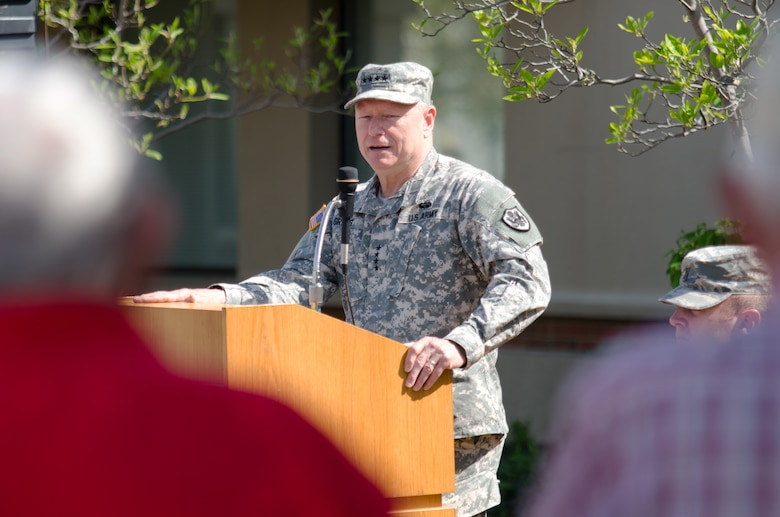 Army Gen. Frank J. Grass, chief of the National Guard Bureau, addresses a crowd of Airmen, friends and family during a ceremony honoring retirees from the 123rd Airlift Wing at the Kentucky Air National Guard Base in Louisville, Ky., April 18, 2015.  During the ceremony, a black granite plaque was unveiled that listed the names of more than 50 Airmen who retired during 2014. (U.S. Air National Guard photo by Senior Airman Joshua Horton)