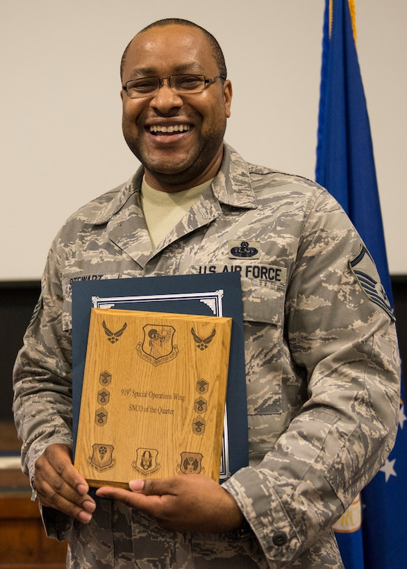 Master Sgt. Narvin Stewart, 919th Special Operations Communications Squadron, displays his plaque as second quarter outstanding senior noncommissioned officer May 3 at Duke Field, Fla.  Quarterly awards recognize individuals that exhibit high standards of performance through leadership and job performance, significant self-improvement, and base or community involvement. (U.S. Air Force photo/Tech. Sgt. Cheryl Foster)