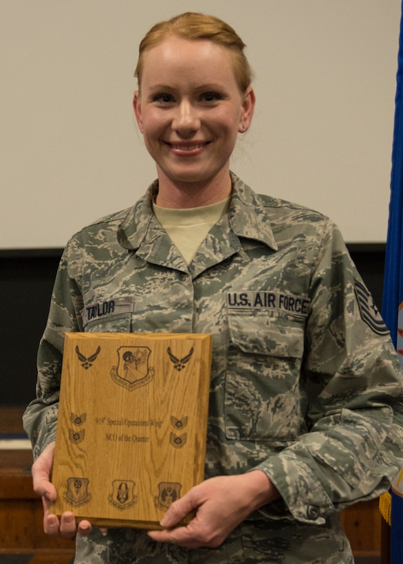 Tech. Sgt. Jasmin Taylor, 919th Special Operations Wing, displays her plaque as second quarter outstanding noncommissioned officer May 3 at Duke Field, Fla. Quarterly awards recognize individuals that exhibit high standards of performance through leadership and job performance, significant self-improvement, and base or community involvement. (U.S. Air Force photo/Tech. Sgt. Cheryl Foster)