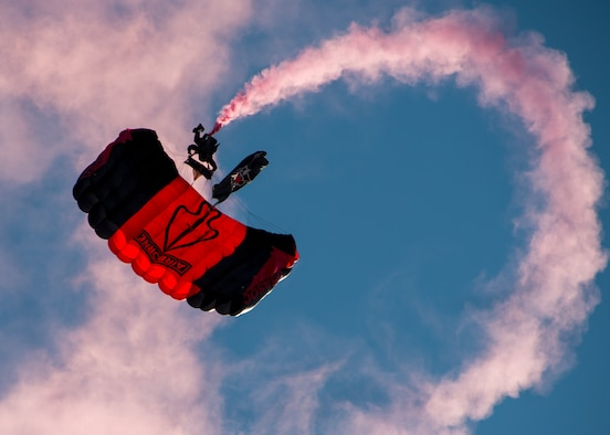 A member of the U. S. Army Special Operations Command's Black Daggers Parachute Demonstration Team parachutes onto Eglin Air Force Base during the 7th Special Forces Group (Airborne) Red Empire Week Community Day May 5.  A Duke Field C-145 flew to serve as the team's free-fall jump platform.  (U.S. Air Force photo/Tech. Sgt. Jasmin Taylor)