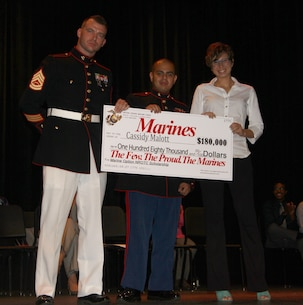 Gunnery Sgt. Gregory Hauk, the station commander for Recruiting Substation Orlando, and Sgt. Magno Choez, a canvassing recruiter for Recruiting Substation Orlando, present Cassidy Malott, a senior from Boone High School, Orlando Fl, with the NROTC Check.  Malott is part of a small percentage that receives the opportunity to become Marine Corps officers.