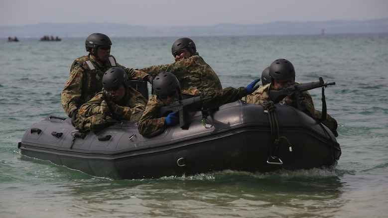 Japanese Ground Self-Defense Force soldiers sight in on their rifles while riding on a Combat Rubber Raiding Craft during the Japanese Observer Exchange Program April 27, 2015 at Kin Blue. JOEP is a III Marine Expeditionary Force, 31st Marine Expeditionary Unit and JGSDF coordinated program designed to increase regional security, maintain unit readiness and enhance overall cooperation. This is the fourth iteration of JOEP for the 31st MEU after the initial partnership in September 2012.  (U.S. Marine Corps photo by Cpl. Ryan C. Mains/Released)