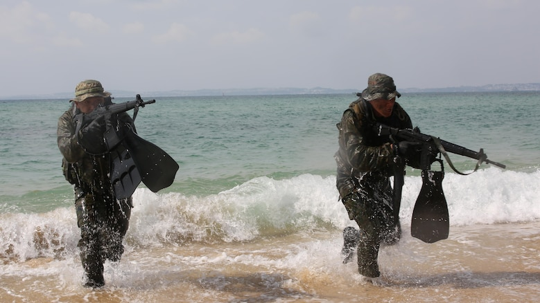 Japanese Ground Self-Defense Force scout swimmers emerge out of the ocean and run to the beach during the Japanese Observer Exchange Program April 27, 2015 at Kin Blue. JOEP is a III Marine Expeditionary Force, 31st Marine Expeditionary Unit and JGSDF coordinated program designed to increase regional security, maintain unit readiness and enhance overall cooperation. This is the fourth iteration of JOEP for the 31st MEU after the initial partnership in September 2012. (U.S. Marine Corps photo by Cpl. Ryan C. Mains/Released)