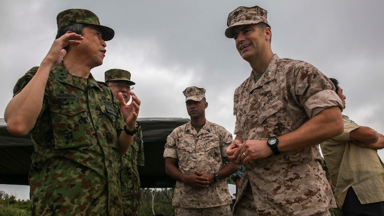 Col. Romin Dasmalchi speaks with Japanese Ground Self-Defense Force soldiers during the Japanese Observer Exchange Program April 28, 2015 at Kin Blue. JOEP is a III Marine Expeditionary Force, 31st Marine Expeditionary Unit and JGSDF coordinated program designed to increase regional security, maintain unit readiness and enhance overall cooperation. This is the fourth iteration of JOEP for the 31st MEU after the initial partnership in September 2012. Dasmalchi is the commanding officer for the 31st Marine Expeditionary Unit. (U.S. Marine Corps photo by Cpl. Ryan C. Mains/Released)