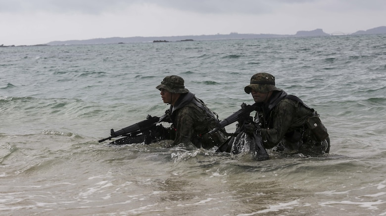 Japanese Ground Self-Defense Force scout swimmers emerge out of the water and sight in on their rifles during the Japanese Observer Exchange Program April 28, 2015 at Kin Blue. JOEP is a III Marine Expeditionary Force, 31st Marine Expeditionary Unit and JGSDF coordinated program designed to increase regional security, maintain unit readiness and enhance overall cooperation. This is the fourth iteration of JOEP for the 31st MEU after the initial partnership in September 2012. (U.S. Marine Corps photo by Cpl. Ryan C. Mains/Released)