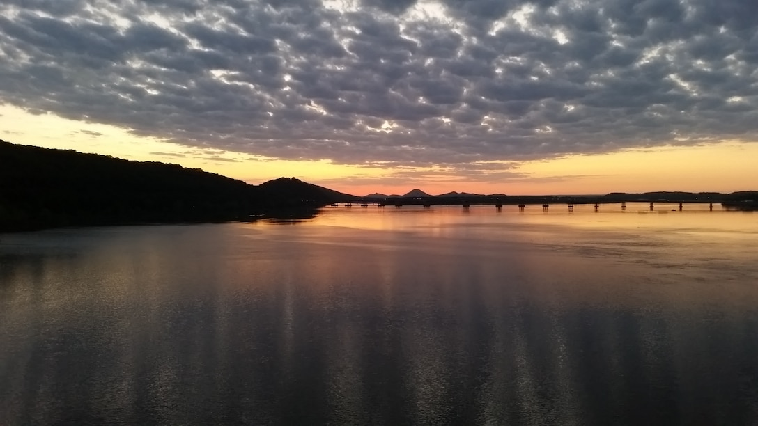 Robert Carr captured this gorgeous sunset from the Big Dam Bridge between Little Rock and North Little Rock. The image is looking up the McClellan-Kerr Arkansas River Navigation System towards Pinnacle Mountain.