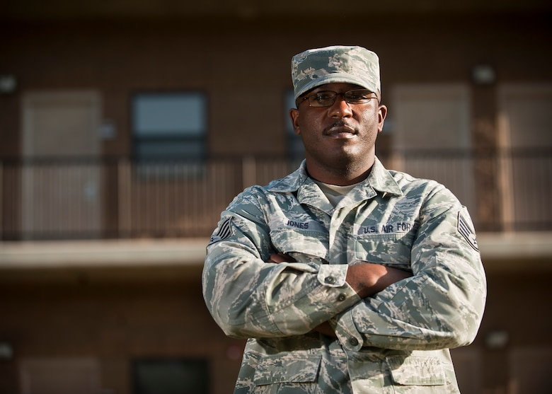 Staff Sgt. Council Jones, the 99th Civil Engineer Squadron airman dormitory leader, stands in front of a dorm on Nellis Air Force Base, Nev., April 7, 2015. As a young Airman, Jones spent 30 days in a correctional confinement facility for an expletive-laced rant directed toward his squadron leadership. He has overcome that past adversity to have a successful Air Force career in which he has won numerous Airman of the Quarter awards and the 52nd Fighter Wing's Airman of the Year award, and has deployed to Iraq and Afghanistan as a security forces member. (U.S. Air Force photo/Staff Sgt. Siuta B. Ika)