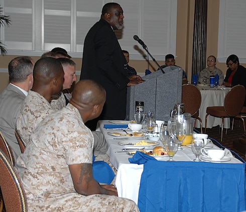 Ira Thompson, inspector general, Marine Corps Logistics Command, address nearly 40 Marines, Sailors and civilian-Marines during the annual National Day of Prayer Breakfast at the Town and Country Restaurant's Grand Ballroom, May 7.