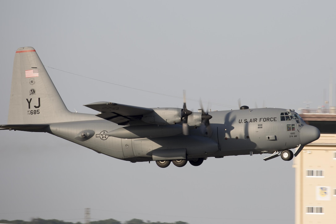 A C-130 Hercules from the 36th Airlift Squadron takes off at Yokota Air Base, Japan, May 5, 2015. Airmen left Yokota to support the U.S. Agency of International Development and the government of Nepal. (U.S. Air Force photo/Osakabe Yasuo)