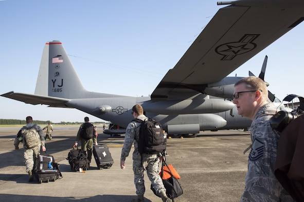 Yokota Airmen board a C-130 Hercules at Yokota Air Base, Japan, May 5, 2015. Airmen departed to conduct humanitarian assistance and disaster relief operations in support of the government of Nepal in the wake of a 7.8 magnitude earthquake that devastated many regions of the country on April 25, 2015. (U.S. Air Force photo/Osakabe Yasuo)
