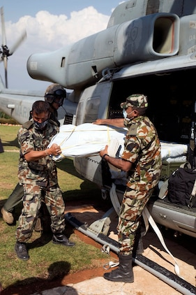 Nepalese military service members unload supplies from a UH-1Y Huey in Charikot, Nepal, May 5. Marines with Marine Light Attack Helicopter Squadron 469 and Marine Medium Tilt Rotor Squadron 262 carried supplies in a UH-1Y Huey and MV-22 Ospreys to Charikot, Nepal. The supplies will provide Nepalese people with shelter after a 7.8 magnitude earthquake struck central Nepal, April 25, causing fatalities, injuries and significant damage. The government of Nepal declared a state of emergency and requested international assistance. The U.S. military, at the direction of the U.S. Agency for International Development, will continue to support Nepal as needed. HMLA-469 and VMM-262 are attached to Marine Aircraft Group 36, 1st Marine Aircraft Wing, III Marine Expeditionary Force.