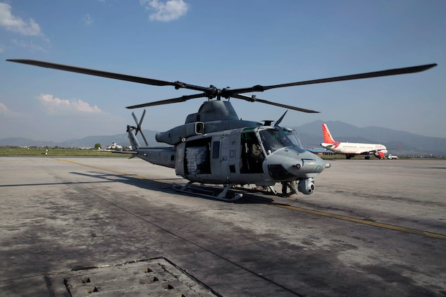 A UH-1Y Huey prepares to take off with supplies at the Tribhuvan International Airport in Kathmandu, Nepal, May 5. Marines with Marine Light Attack Helicopter Squadron 469 and Marine Medium Tilt Rotor Squadron 262 carried supplies in a UH-1Y Huey and MV-22 Ospreys to Charikot, Nepal. The supplies will provide Nepalese people with shelter after a 7.8 magnitude earthquake struck central Nepal, April 25, causing fatalities, injuries and significant damage. The government of Nepal declared a state of emergency and requested international assistance. The U.S. military, at the direction of the U.S. Agency for International Development, will continue to support Nepal as needed. HMLA-469 and VMM-262 are attached to Marine Aircraft Group 36, 1st Marine Aircraft Wing, III Marine Expeditionary Force.