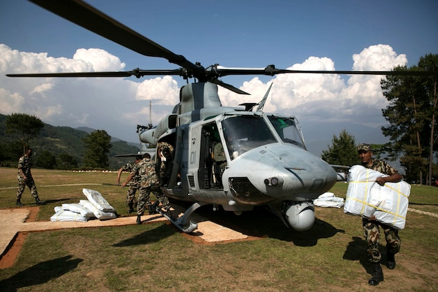 Nepalese military service members unload supplies from a UH-1Y Huey in Charikot, Nepal, May 5, Nepal, May 5. Marines with Marine Light Attack Helicopter Squadron 469 and Marine Medium Tilt Rotor Squadron 262 carried supplies in a UH-1Y Huey and MV-22 Ospreys to Charikot, Nepal. The supplies will provide Nepalese people with shelter after a 7.8 magnitude earthquake struck central Nepal, April 25, causing fatalities, injuries and significant damage. The government of Nepal declared a state of emergency and requested international assistance. The U.S. military, at the direction of the U.S. Agency for International Development, will continue to support Nepal as needed. HMLA-469 and VMM-262 are attached to Marine Aircraft Group 36, 1st Marine Aircraft Wing, III Marine Expeditionary Force.