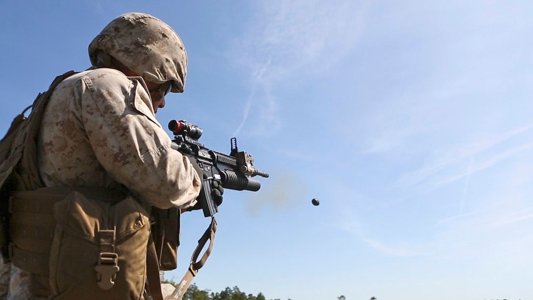 Lance Cpl. Xavier Castro, a rifleman with 1st Battalion, 8th Marine Regiment, fires his M203 rifle-mounted grenade launcher during a M203 qualification aboard Marine Corps Base Camp Lejeune, North Carolina, April 5, 2015. The M203 grenade launcher fires various types of 40 mm ammunition, ranging from high explosive to ground marking rounds.