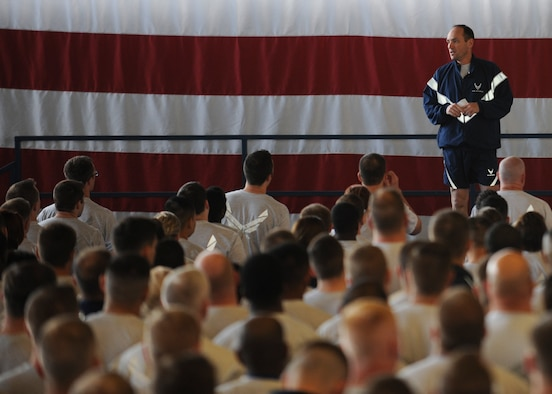 Col. Kevin Kennedy, 28th Bomb Wing commander, addresses Ellsworth Airmen during a commanders call inside the Pride Hangar at Ellsworth Air Force Base, S.D., April 23, 2015. Kennedy kicked off Comprehensive Airman Fitness day events by highlighting the importance of social resilience and sexual assault prevention and response training. (U.S. Air Force photo by Senior Airman Anania Tekurio/Released)