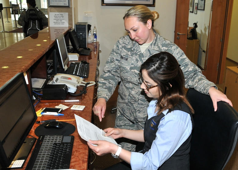 Staff Sgt. Adrianne Johnson, 104th Services Flight, Barnes Air National Guard Base, Westfield, Mass., receives training on front desk procedures from Ayesgui Gignac, Guest Services Representative, May 7, 2015, on the front desk computer system, Air Force Inn, Kaiserslautern Military Community Center, Ramstein Air Base, Germany. Johnson trained at the KMCC Air Force Inn May 5-7 in the areas of housekeeping, inspecting rooms, accounting, reservations, and supply, allowing her to sign off on requirements for her services position. (U.S. Air National Guard photo by Tech. Sgt. Melanie J. Casineau/ Released)