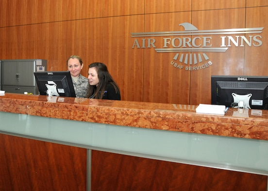 Staff Sgt. Adrianne Johnson, 104th Services Flight, Barnes Air National Guard Base, Westfield, Mass., receives training from Alley Carollo, Guest Services Representative, May 7, 2015, on the front desk computer system, Air Force Inn, Kaiserslautern Military Community Center, Ramstein Air Base, Germany. Johnson trained at the KMCC Air Force Inn May 5-7 in the areas of housekeeping, inspecting rooms, accounting, reservations, and supply, allowing her to sign off on requirements for her services position. (U.S. Air National Guard photo by Tech. Sgt. Melanie J. Casineau/ Released)
