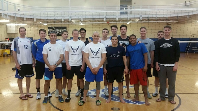 Senior Airman Jan C. Flores, 9th Aircraft Maintenance Squadron radio frequency technician (center) and fellow selectees for the All-Air Force Men's Volleyball Trial Camp pose for a photo on the Air Force training court at Hanscom Air Force Base, Mass., May 6, 2015. Airmen who earn a spot on the final team will go on to represent the Air Force at the Armed Forces National Men's Volleyball Championship in Detroit, May 22 to 27, 2015. (Courtesy photo)
