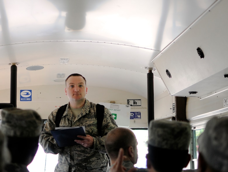Oregon Air National Guard Master Sgt. Robert Vickery, first sergeant, 142nd Fighter Wing Civil Engineer Squadron (CES) conducts a role call of squadron members as they board a bus  at the Portland Air National Guard Base, Ore., May 5, 2015. The 142nd CES is taking part in a mission to Romania to rebuild an aging hospital as part of US European Command's Humanitarian Assistance Program. (U.S. Air National Guard photo by Staff Sgt. Brandon Boyd, 142nd Fighter Wing Public Affairs/Released)