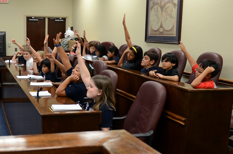 Andersen Elementary School fourth graders take part in the 36th Wing paralegal team's Alice in Wonderland-themed mock trial deliberation at the base courtroom May 1, 2015, at Andersen Air Force Base, Guam. This year, Law Day commemorated the 800th anniversary of the signing of the Magna Carta. (U.S. Air Force photo by Airman 1st Class Alexa Ann Henderson/Released)