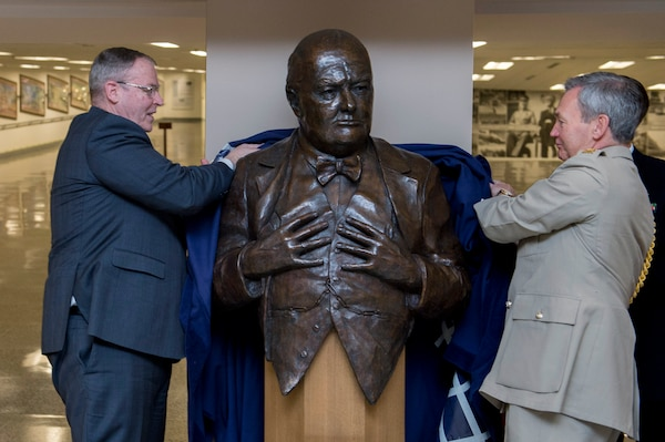 Deputy Defense Secretary Bob Work and United Kingdom Chief of Defense Gen. Nick Houghton unveil a bust of Sir Winston S. Churchill during a ceremony at the Pentagon, May 6, 2015. The United Kingdom defense ministry presented the bust to the Department of Defense. DoD photo by Air Force Master Sgt. Adrian Cadiz