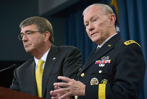 Chairman of the Joint Chiefs of Staff Gen. Martin E. Dempsey answers a reporter's questions as Defense Secretary Ash Carter listens during a press conference in the Pentagon Briefing Room May 7, 2015. DoD Photo by Glenn Fawcett
