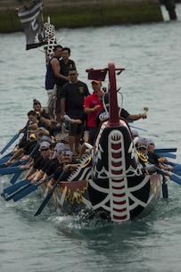 The Single Marine Program dragon boat team competes in the 41st annual Naha City Dragon Boat Races, also known as Harii,  May 5 at Tomari Port in Naha City, Okinawa. The SMP dragon boat team was made up of approximately 44 Marines and sailors. They began practicing two months prior to the competition, according to Satsuki Fraling, the SMP coordinator with Marine Corps Community Services. A dragon boat is a human-powered watercraft originating from China, according to Fraling, a Naha City, Okinawa, native. It became a tradition where fishermen took boats out to sea to pray for safe travels and health for the upcoming year. Later the tradition evolved into a festival taking place on Okinawa. (U.S. Marine Corps photo by Lance Cpl. Brittany A. James/Released)