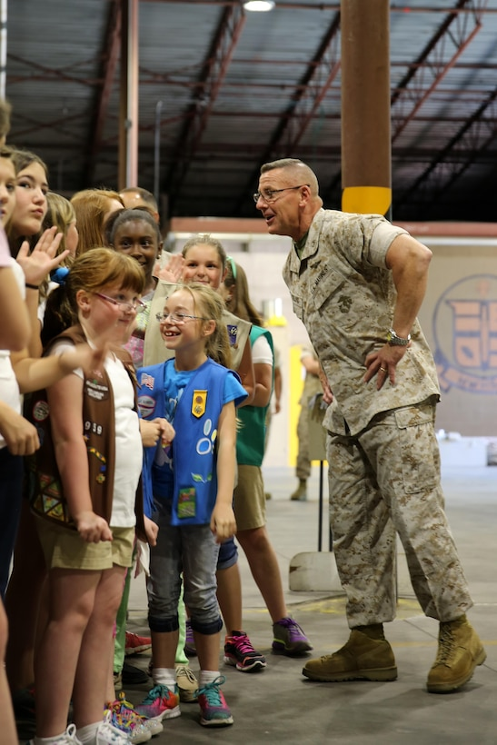 Maj. Gen. Robert F. Hedelund talks to 33 Girl Scouts about Operation Cookie Drop following the delivery of 8,400 Girl Scout cookies to Marine Corps Air Station Cherry Point, North Carolina, April 4, 2015. Hedelund is the commanding general, 2nd Marine Aircraft Wing.